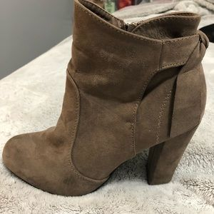 Medium brown booties with a bow